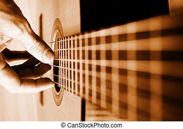Acoustic Guitar Player Close-up With Focus On The Hand -...