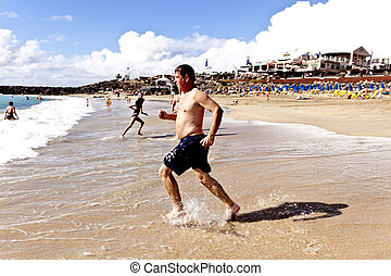 man running at the beach