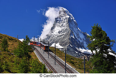 Matterhorn with railroad and train - Mountain train in front...