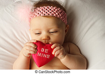 Baby Heart Look - Valentines day picture of baby holding a...