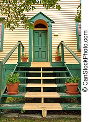 stairs leading to a green door