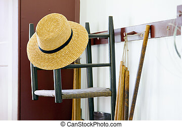 Shaker Peg Rail - Hat and chair hanging on a traditional...