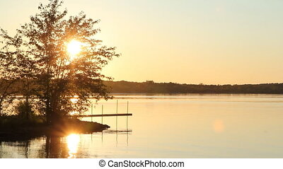 Cottage sunset. Two shots. - Sunset by the lake. Cottage...