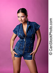 Pretty young woman portrait in jeans suit