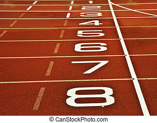 Athletics running track start finish line - Close up of...