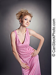 Young beauty woman posing in rose frock