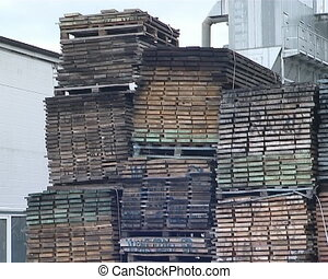 Huge piles of cut boards in sawmill prepared for...