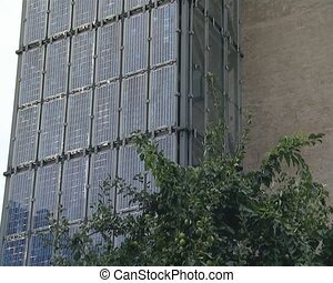 Lof of solar collectors installed on the building walls in...