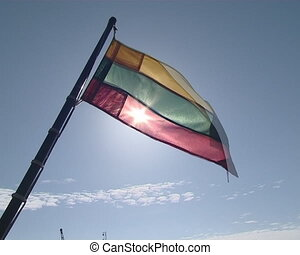 Lithuanian tricolor flag flies on board of motor boat and...