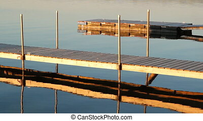 Sunset docks. - Sun on docks by the lake. Cottage country in...