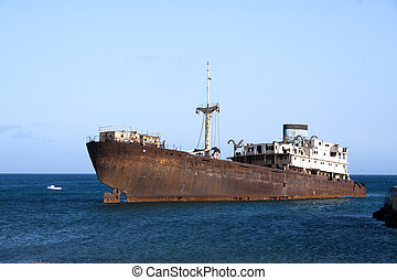 rusty ship on the shore in Lanzarote, Canary Islands, Spain