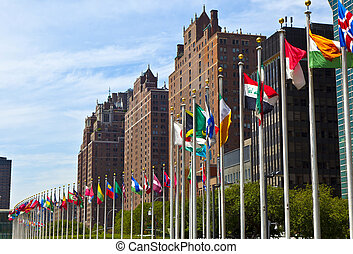United Nations Headquarters with flags of the members of the...