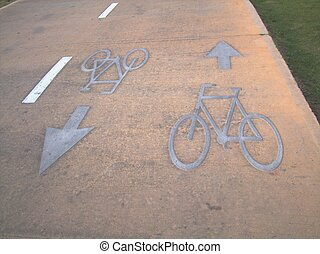 Bicycle lane sign on road