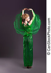 Beauty woman dance in transparent green cloth