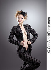 Young beauty woman with nude breast in retro suit