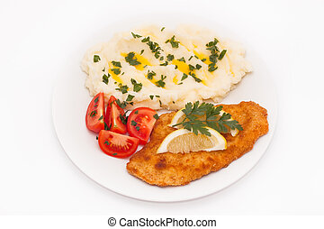 Schnitzel with lemon, tomatoes and potato mash, isolated on...