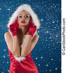 red and sexy santa claus girl - young and sexy woman in red...