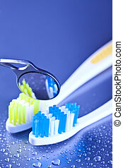toothbrushes and dental mirror