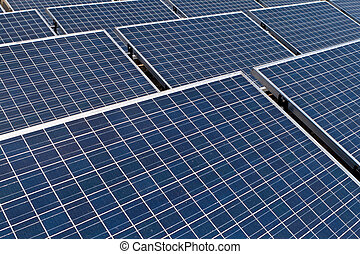 Rows of Tilted Photovoltaic Solar Panels