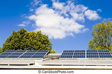 Solar Panels on Roof of Home, Blue Sky - Solar panels on a...