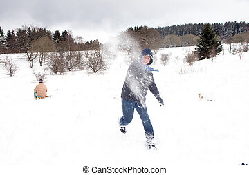 children have a snowball fight in white winter, snow bullet...