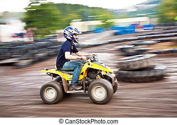 boy enjoys Quad driving - young boy is faszinated by quad...