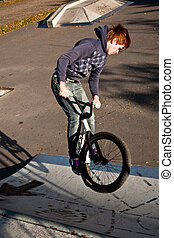 young boy with dirtbike in halfpipe - young red haired boy...