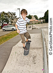 boy skating at the skate park and has fun