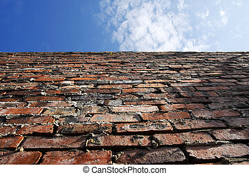 Old brick wall and blue sky - Old brick wall with blue sky...