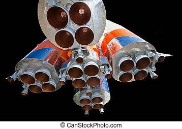 Space rocket engine over black background