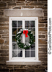 Christmas Wreath on Old Window Pane - A green spruce...