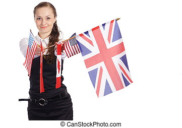 girl with flags - cute young woman posing on a white