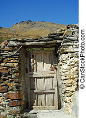 Old Spanish Village - wooden door and mountains