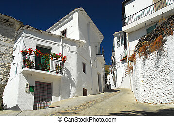 Narrow street in Spanish village in mountains