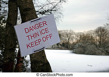 Danger thin ice sign by a lake