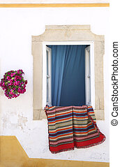 Portugese house with rug - Colorful rug haning from a window...