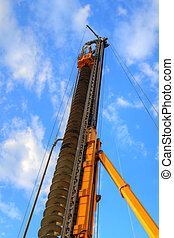 Drilling rig - Yellow drilling rig with blue sky in the...