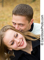 cute young couple - portrait of a cute young couple at park