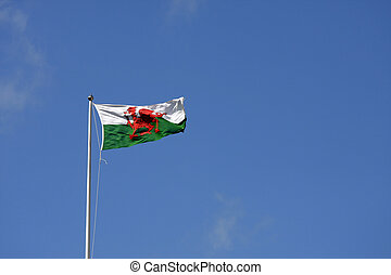 Welsh flag flying against a blue sky