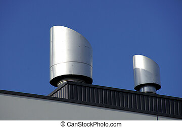 Rooftop vents - Vents of ventilation are located on a roof...
