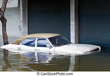 Car inundated during a flood in Bangkok, Thailand - Stranded...