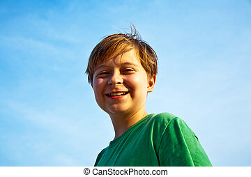 happy boy at the beach - happy smiling young boy with...