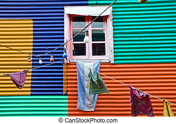 Colourful window with laundry in La