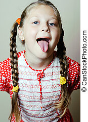 Girl - An image of a little girl showing her tongue