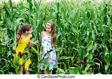 Cousins - An image of two little girls in the green...