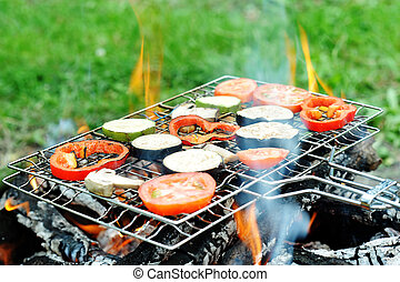Barbecue - An image of a grill with vegetables on it