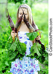 Beet - An image of a girl with beetroots in her hands