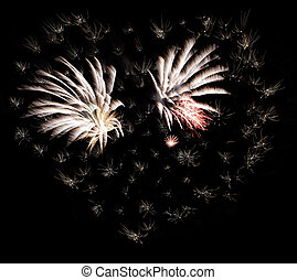 Fireworks Heart - Fireworks forming a heart shape in the...