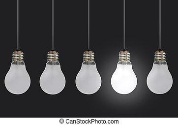 Light bulbs - One lit bulb amongst a row of unlit bulbs,...
