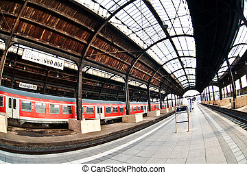 classicistic trainstation in Wiesbaden with trains and a...
